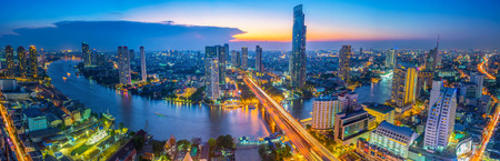 Landscape of river in Bangkok cityscape in night time.
