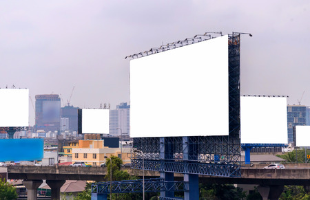 street signs: large blank billboard with city view background.