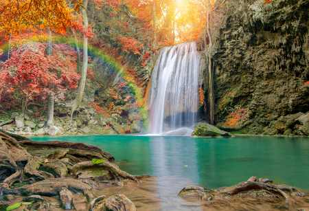 wonder: Wonderful Waterfall with rainbows and red leaf in Deep forest at Erawan waterfall National Park, Kanjanaburi Thailand. Stock Photo