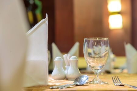 dinning room: Elegance of glasses on table set up for dinning room. Stock Photo
