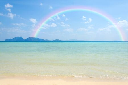 pristine corals: Colorful rainbow over a tropical beach of Andaman Sea, Thailand.