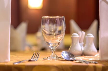 set up: Elegance glasses on table set up for dinning room. Stock Photo