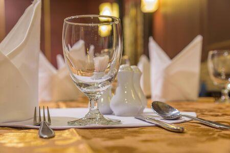 set up: Elegance glasses on table set up for dinning room. Stock Photo