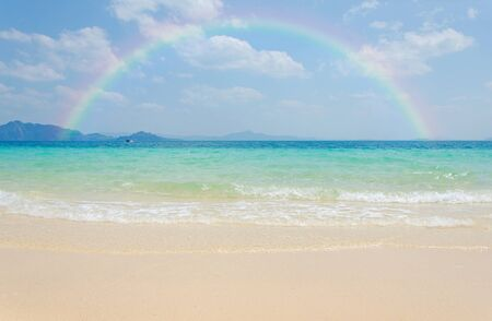 pristine corals: Colorful rainbow over a Tropical beach of Andaman Sea, Thailand. Stock Photo