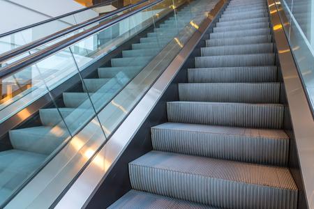 escalators stairway inside modern office building. 스톡 콘텐츠
