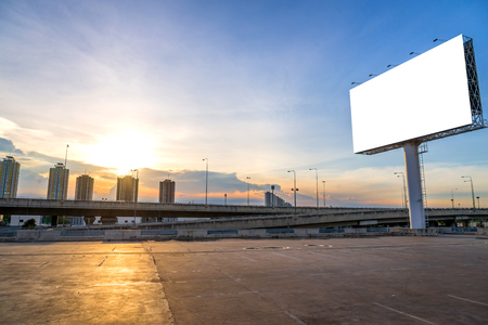 banner ads: large Blank billboard ready for new advertisement with sunset.