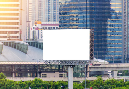 billboard: large blank billboard with city view background.