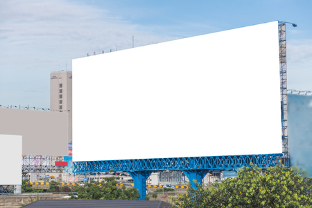 billboard blank: large blank billboard on overpass with city view background. Stock Photo