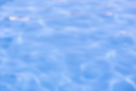 waterpool: blurred of blue swimming pool with sunny reflections. Stock Photo
