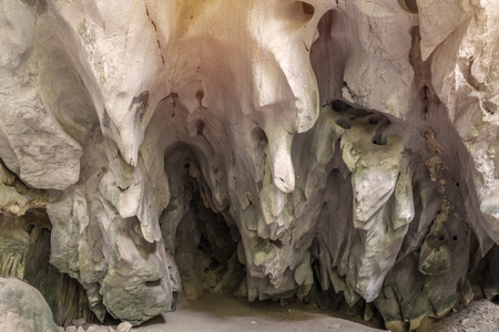 drop ceiling: cave in the mountain, with stalagmites and stalactites.