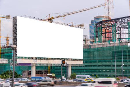 site: Blank billboard ready for new advertisement on road with Construction site. Stock Photo