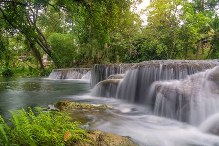 heaven background: Waterfall in rain forest at national park.