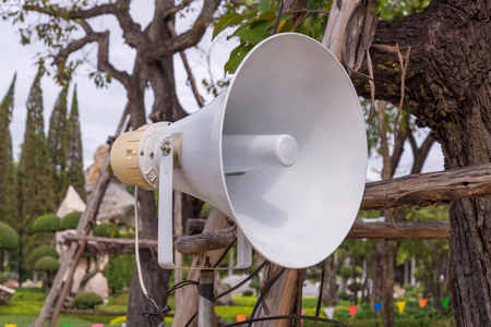 amplification: Megaphone in garden at public park. Stock Photo
