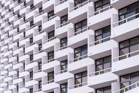 balcony of apartment building in city.
