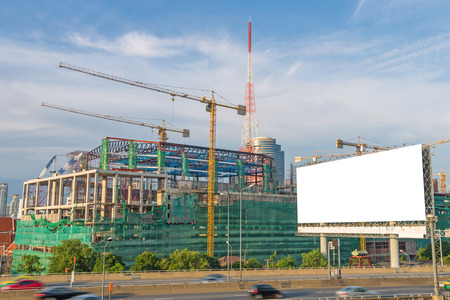 road construction: Blank billboard ready for new advertisement on road with Construction site. Stock Photo