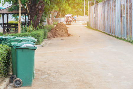 segregate: trash cans in the park beside the walk way. Stock Photo