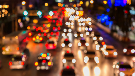 abstact blur bokeh of Evening traffic jam on road in city. Archivio Fotografico