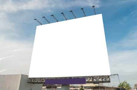 large blank billboard on building in city view background. Standard-Bild