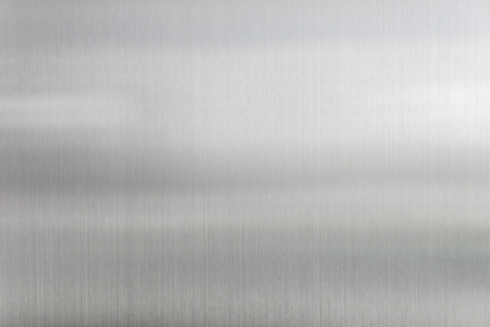 shiny metal background: texture metal background of brushed steel plate. Stock Photo