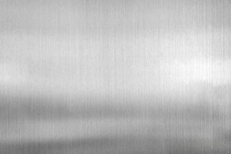 テクスチャ ブラシをかけられた鋼板の金属の背景。 写真素材