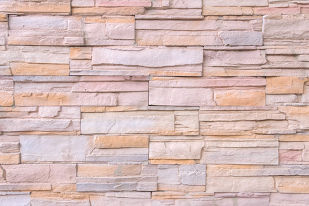 stonemason: Brown marble brick wall abstract for background.
