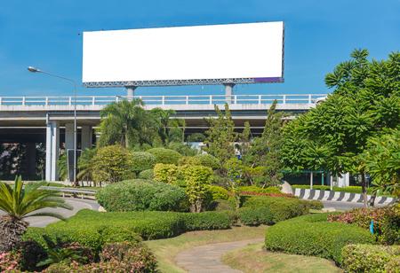 billboard: Blank billboard ready for new advertisement with garden.