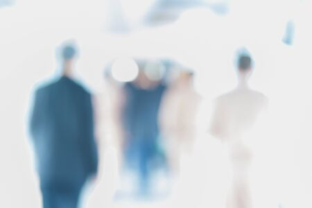 businesslike: Blurred of people walking in the corridor of an business center, pronounced motion blur. Stock Photo