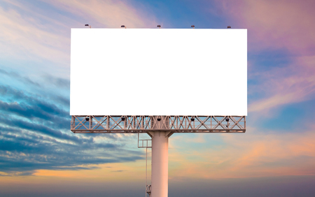 billboard background: Blank billboard ready for new advertisement with sunset background. Stock Photo