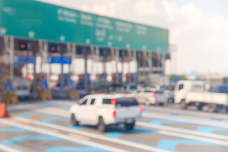 toll: blurry of car in Toll collecting on the expressway in Bangkok Thailand.
