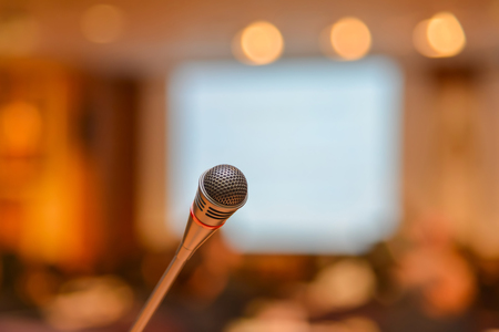 amplification: Microphone in meeting room before a conference.