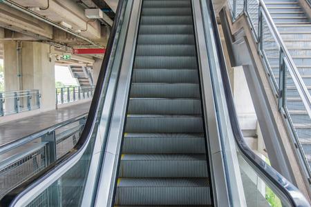 rapid steel: escalators stairway inside modern office building. Stock Photo