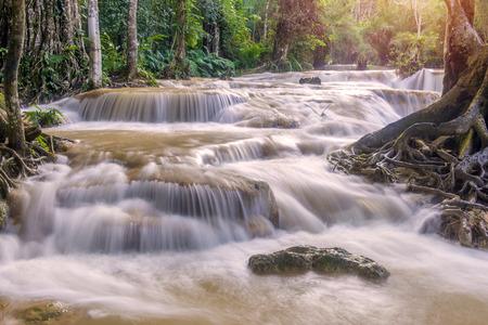 tat: Flash flood in Waterfall at Tat Kuang Si Luang prabang, Laos.