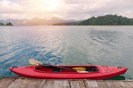 sok: Floating red Canoe in Ratchaprapha Dam at Khao Sok National Park, Thailand