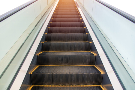 rapid steel: old escalators stairway inside modern office building.