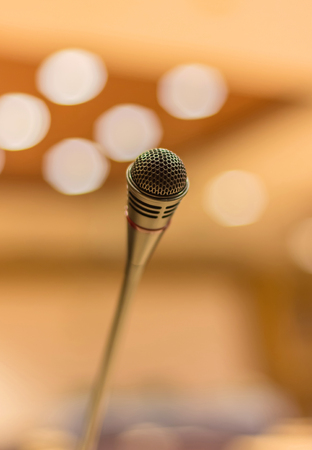 amplify: Microphone in meeting room before a conference.