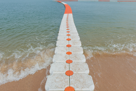 rope barrier: buoy barrier on sea surface to protect people from boat. Stock Photo