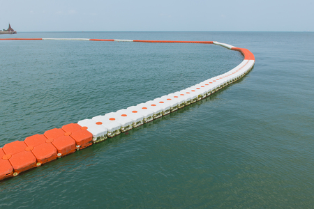 buoy barrier on sea surface to protect people from boat. Stock Photo