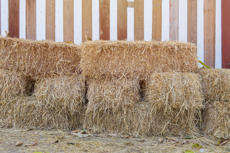 ruminate: stack of straw or hay bales in a rural landscape.