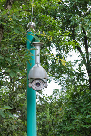 Security CCTV camera and urban video at public park. Stock Photo