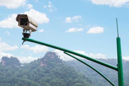 larceny: Security CCTV camera and urban video at public park. Stock Photo