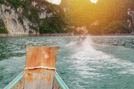 Wooden boat on Ratchaprapha Dam Khao Sok National Park, Surat Thani Province, Thailand.