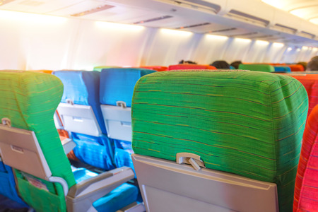 Airplane seat with in cabin of huge aircraft. Stock Photo