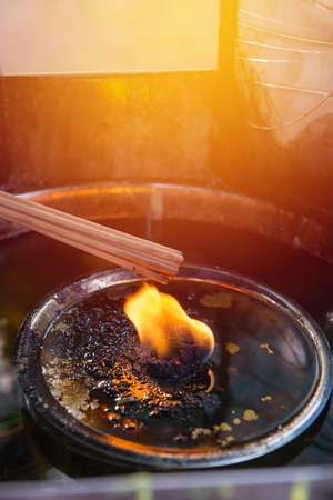 Burning red incense sticks in temple at Thailand. Stock Photo
