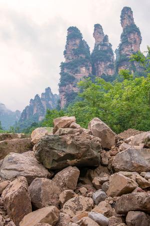 landscape of three Mountain looks like (Three sisters rock formation ) in Ten-Mile Gallery, Hunan province ZhangJiaJie CHINA. Stock Photo