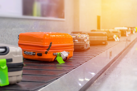 Suitcase or luggage with conveyor belt in the airport. Stock Photo