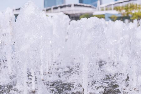 eruptive: Fountain water spout spray in luxury basin or The gush of water in fountain.