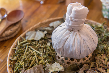 compress: herbal spa balls for treatment or massage with herb bergamot and ginger.