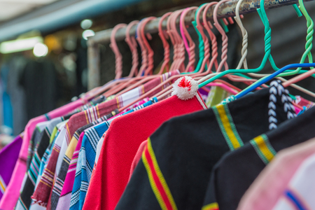 closet: Colorful clothes fashion hang on a shelf at flea market shopping in town. Stock Photo
