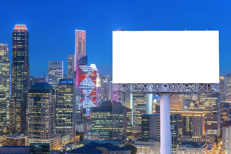 Blank billboard for advertisement in city downtown at night.