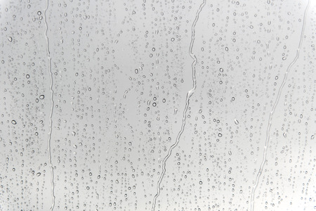 h2o: water drops on glass after rain for background. Stock Photo